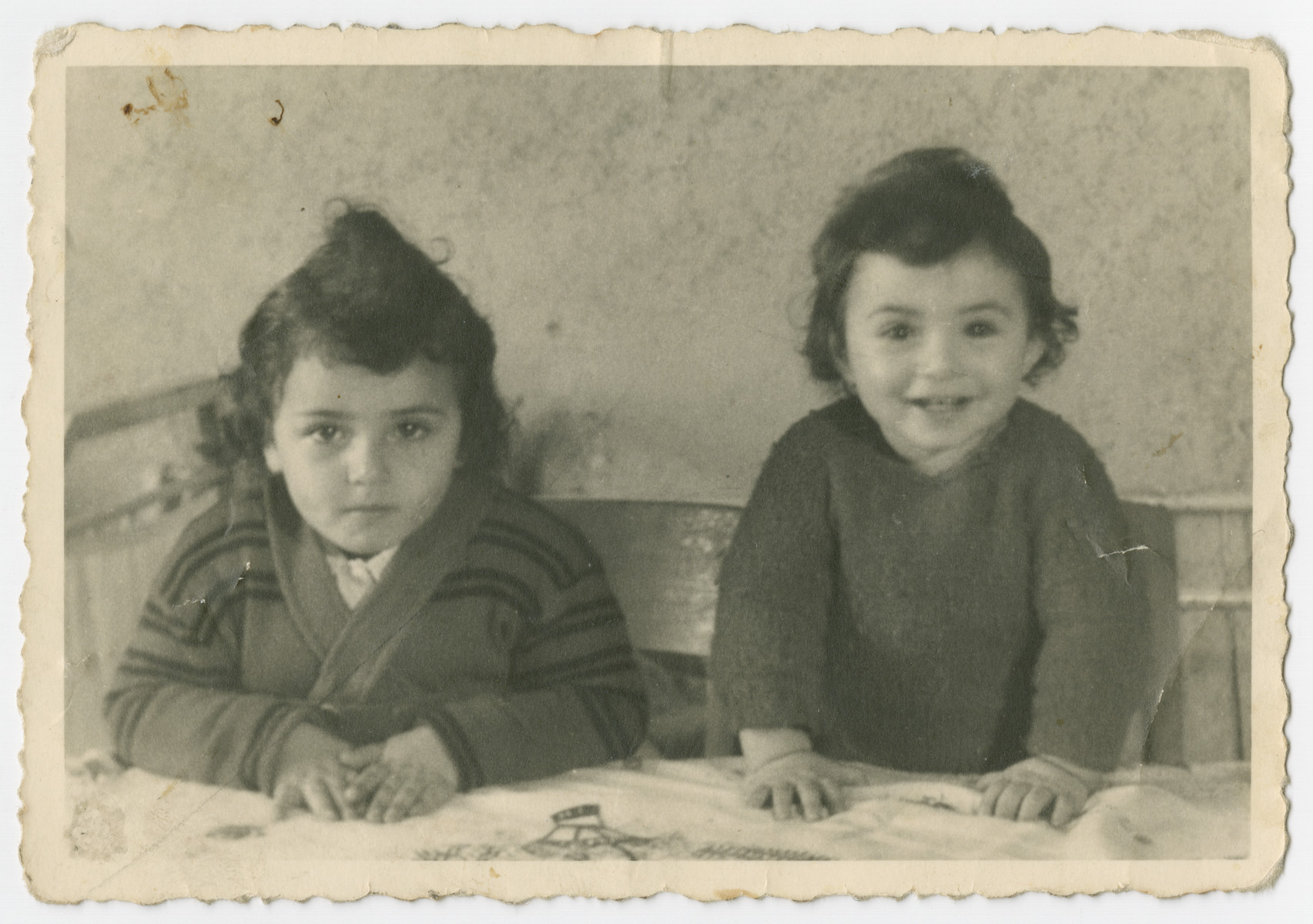 Close-up portrait of sisters Ellen and Rosa Zinger (children of Malka and Abram Zinger) in Belgium, prior returning to the Bergen-Belsen displaced persons camp.