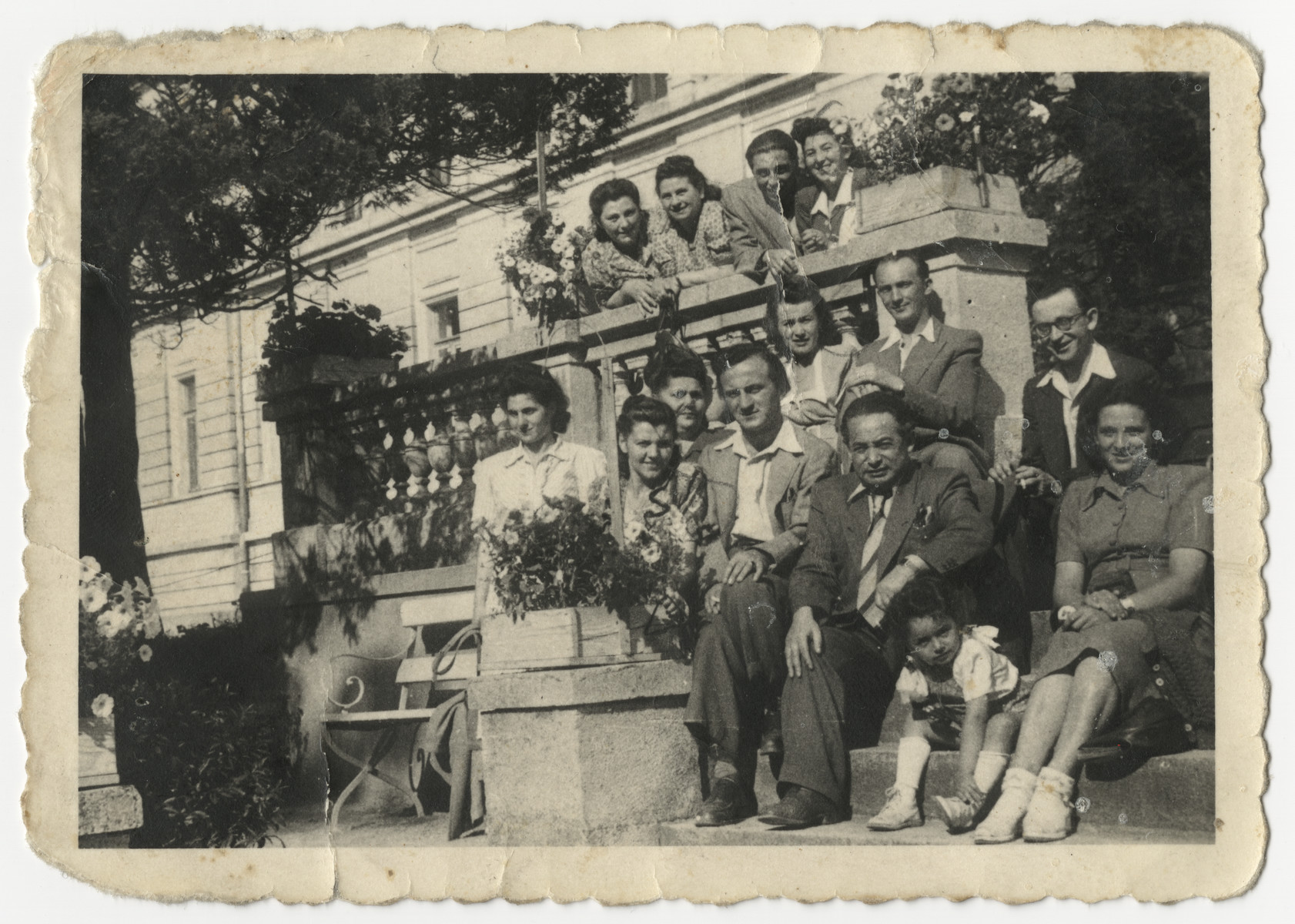 Group portrait of Jewish DPs recovering in a sanatorium in Germany.  Malka Zinger is seated on the lower right with her daughter Ellen.