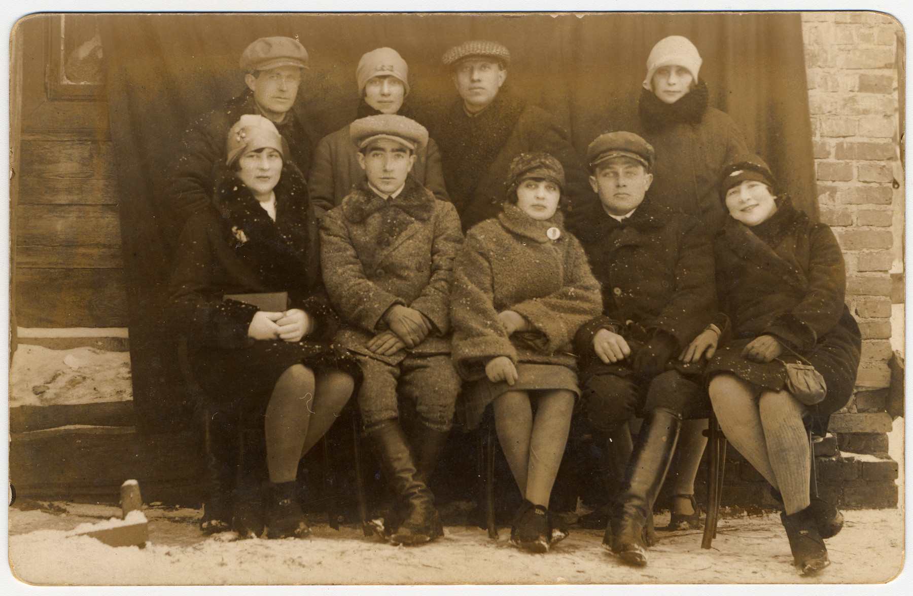 Group portrait of young Jewish adults (many of them cousins of the donor's father) in Zelva.  Among those pictured are Yussel Freidin (standing center), Feigel Moorstein (seated left), Esther Moorstein (wife of Yussel Freidin, seated right) and Sarah Bereshkovsky (standing second from the left).