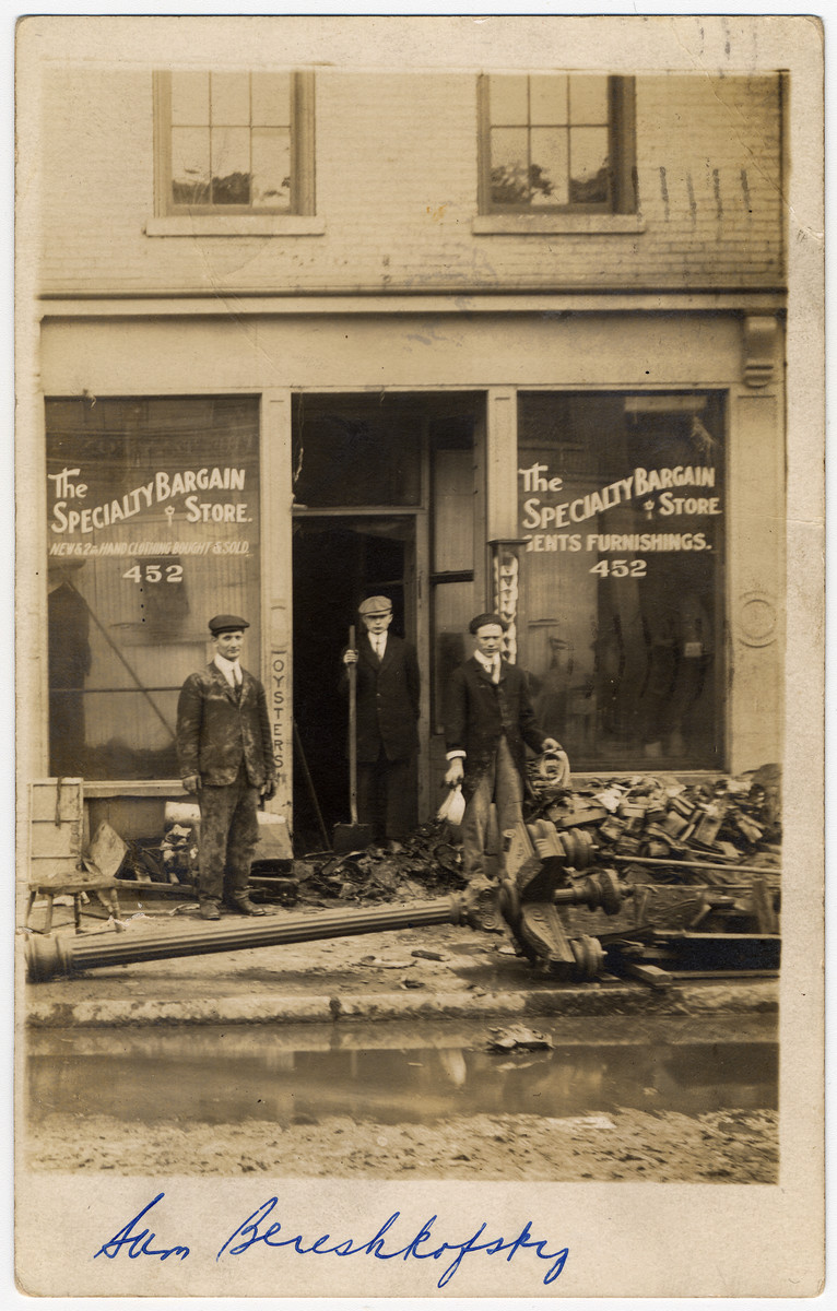 Sam (Zalman) Bereshkovsky helps clean up some rubble outside a store in Dayton, OH.  Zalman Bereshkovsky (b. 1895) immigrated to the United States only to return to Poland to serve in World War I.  He later died in the Holocaust, probably in Treblinka.