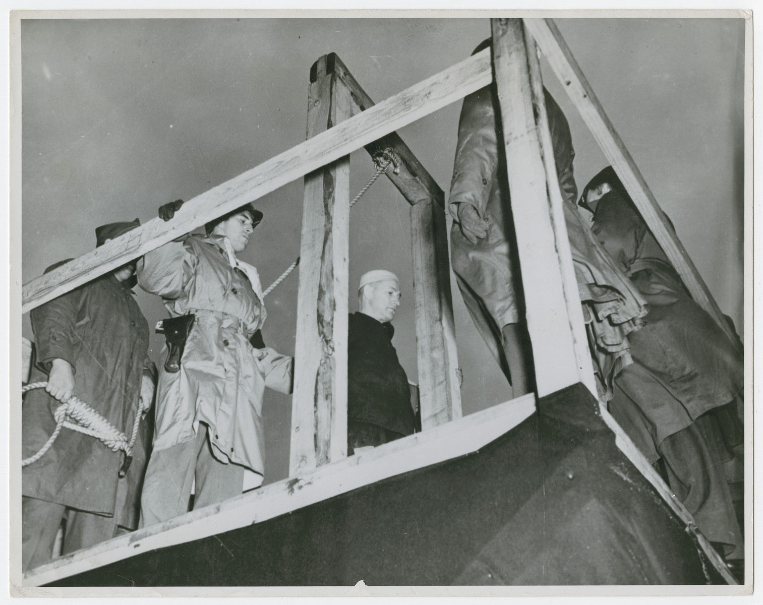 "Clemens Wiegand is hanged after being sentenced for the murder of a captured American airman in November, 1944.  Original caption reads:  ""The sentence of death by hanging is read to Clemens Wiegand, former Wehrmacht Sergeant, convicted of murdering a defenseless American airman whom he had taken prisoner""."