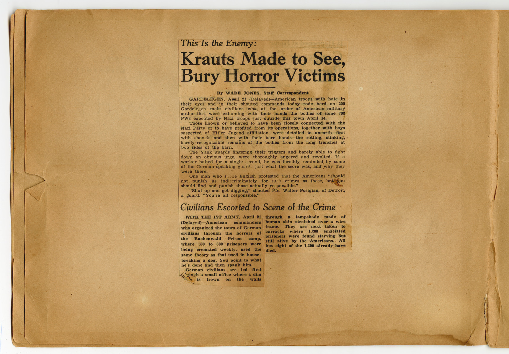 "Newspaper clipping about forced confrontation pasted into a photograph album titled ""Buchenwald/or a Glance at German ""Kultur"""" by Murray Bucher."