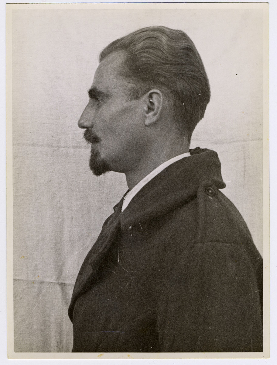 Mug shot of Nazi physician Dr. Fridolin Karl Puhr stationed at Dachau, who was arrested when the camp was liberated by American forces on April 29, 1945.
