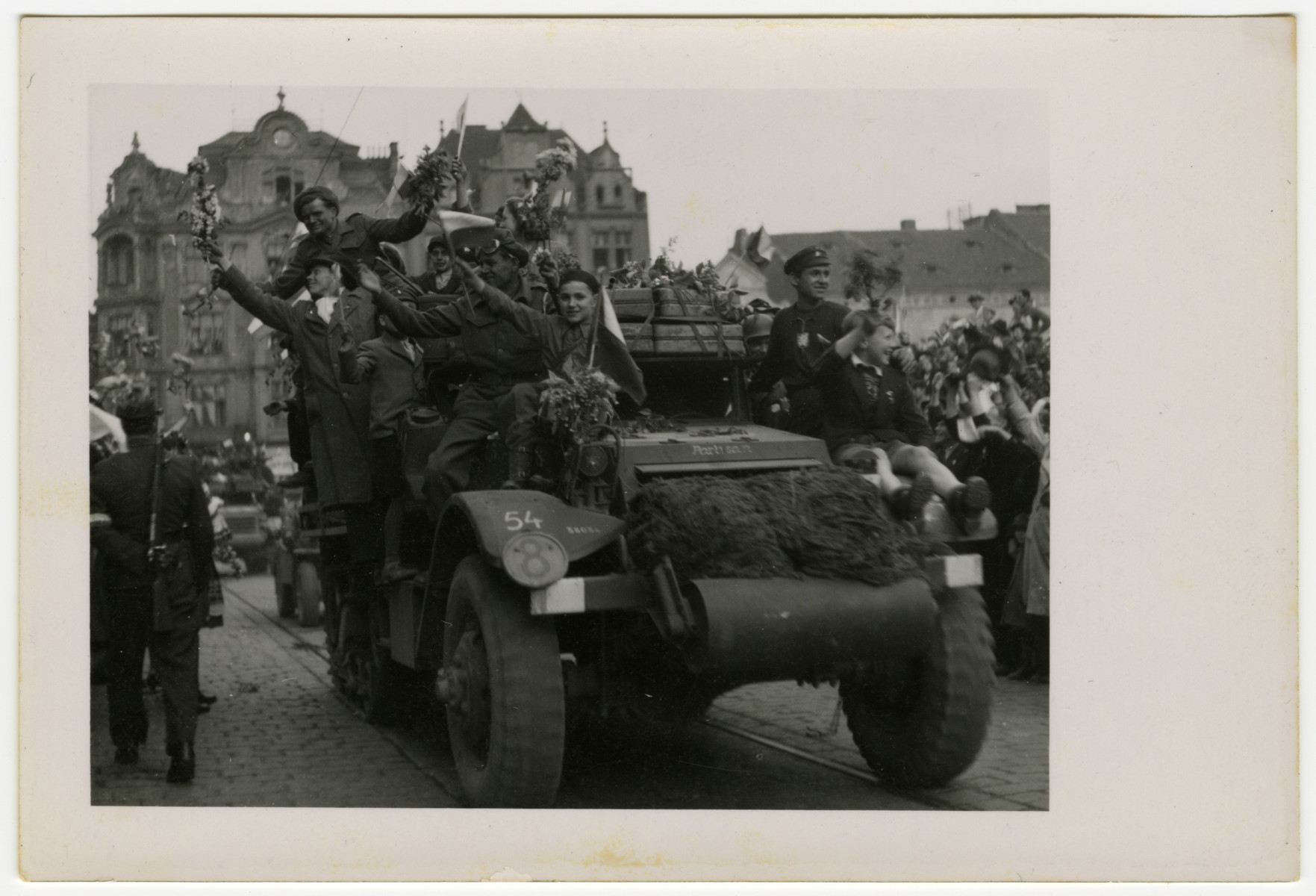 Residents of Pilsen, Czechoslovakia ride on an army truck in the parade celebrating the town's liberation.