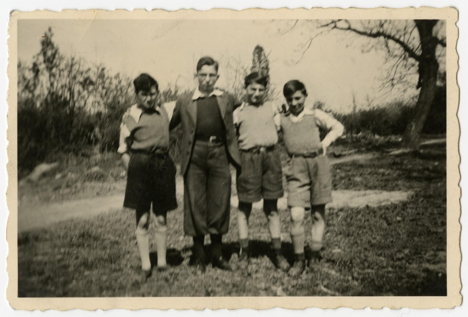 Group portrait of four Jewish orphans outside Home de la-Bas in Aische-en-Refail.  Pictured are Leon Pec, George Sylin, Maurice Sorgenstein and Charles Rojer.