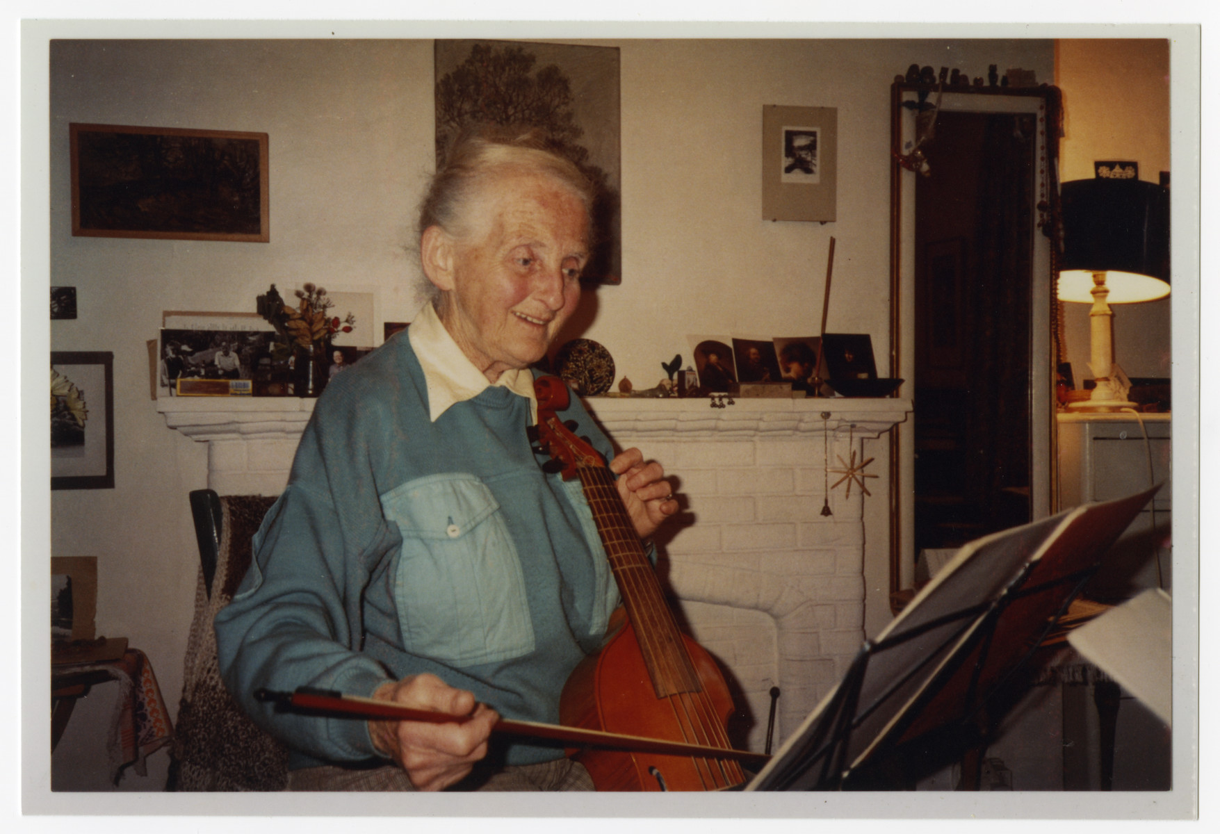 Suse Tieze, one of the care givers in Weir Courtney, plays a violin cello.