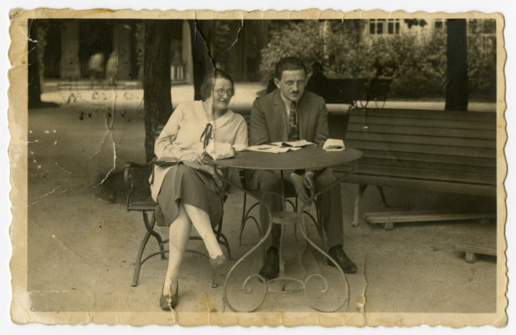 Bertha and Emil Forchheimer rest at an outdoor table while on their honeymoon.