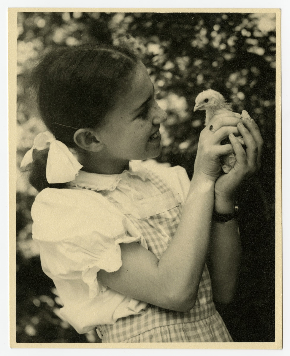 Zdenka Husserl holds a young bird, probably at Isleworth.