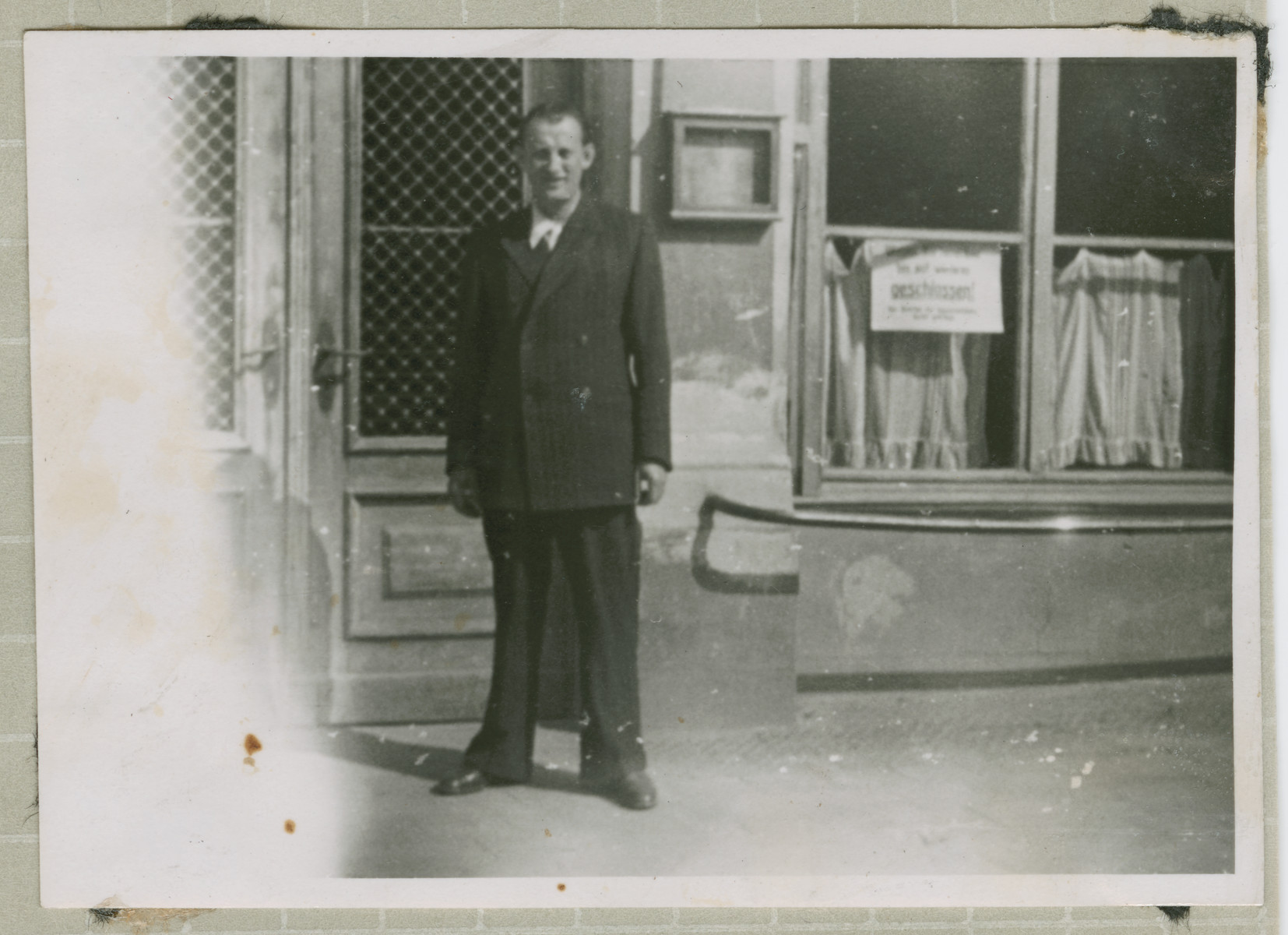 Salo Bratman stands in front of a building, probably after the war.