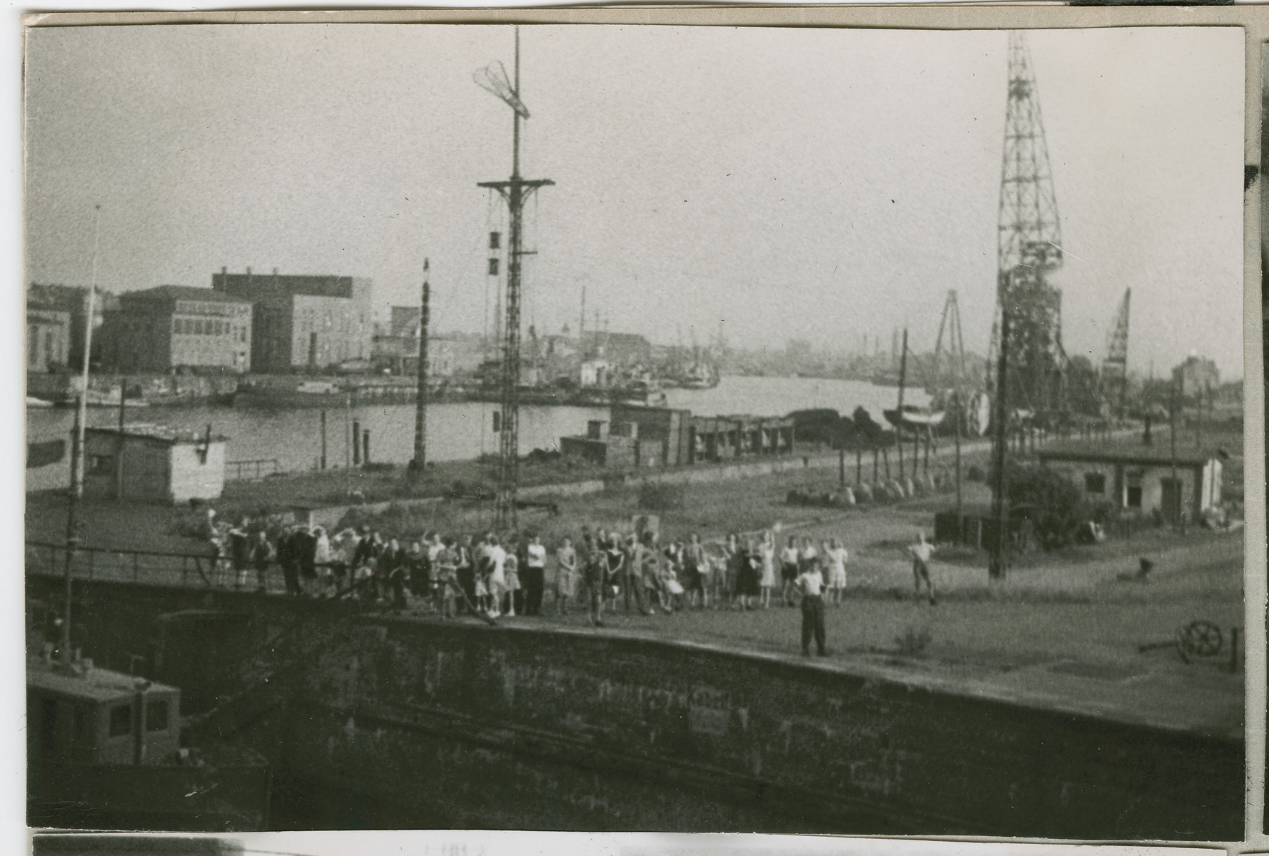 Men and women gather by the pier in Bremen to say good bye to the Marine Flasher.