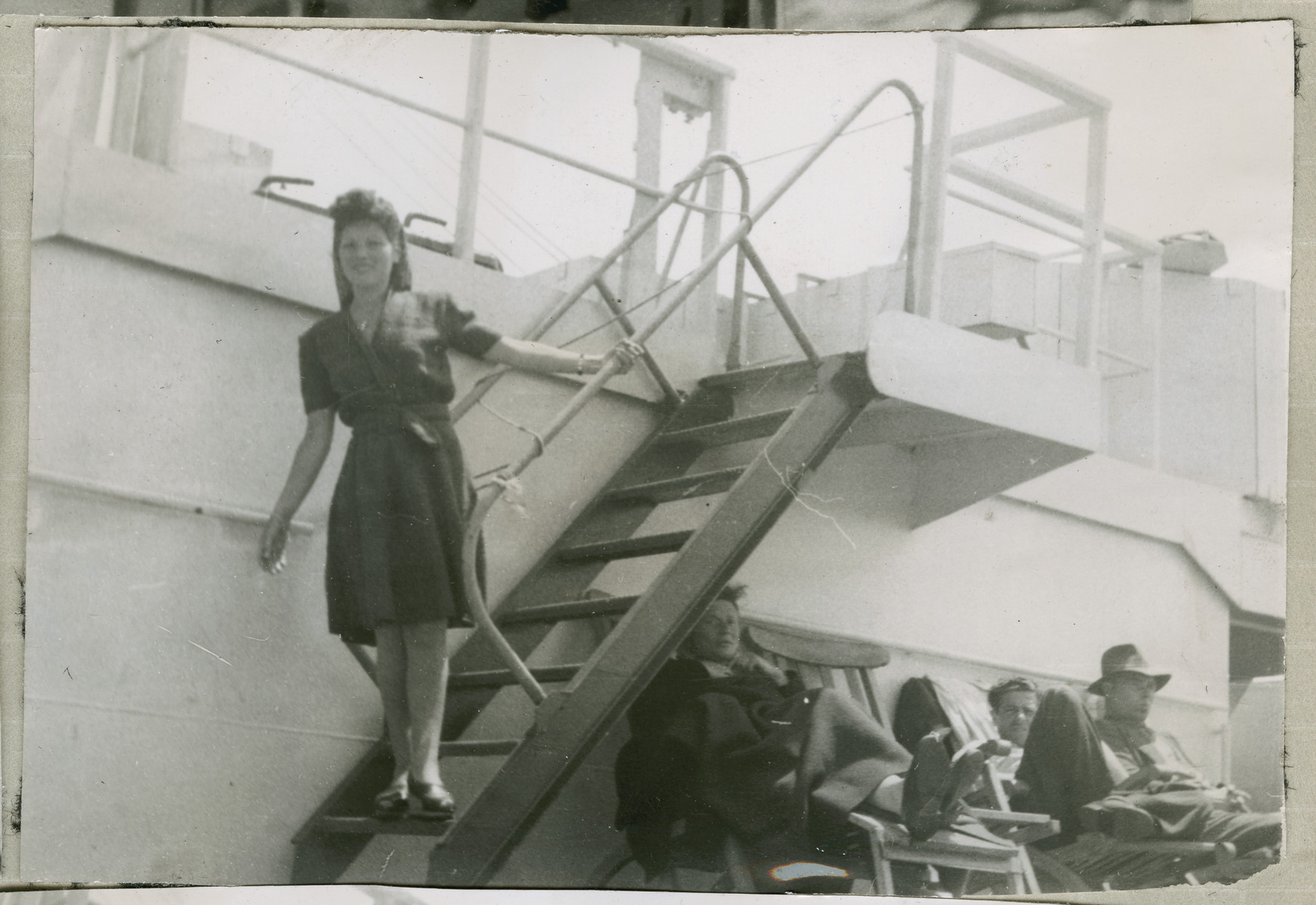 Hanna Bratman walks down a short flight of steps on the deck of the Marine Flasher.