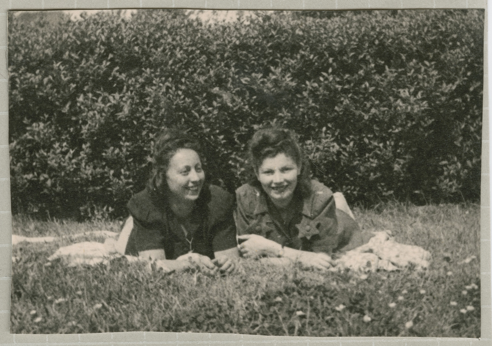 Hanka Bratman Fisch and Hanna Bratman lie on the lawn of the Lampertheim displaced persons camp.