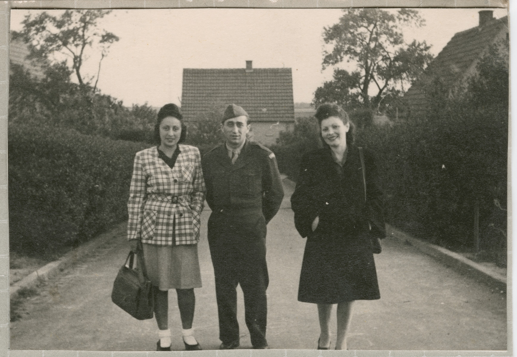 Three Jewish DPs stand on a street iin the Lampertheim displaced persons camp.    From left to right are Hanka Bratman Fisch, her husband Theodore (Tadek) Fisch and Hanna Bratman.