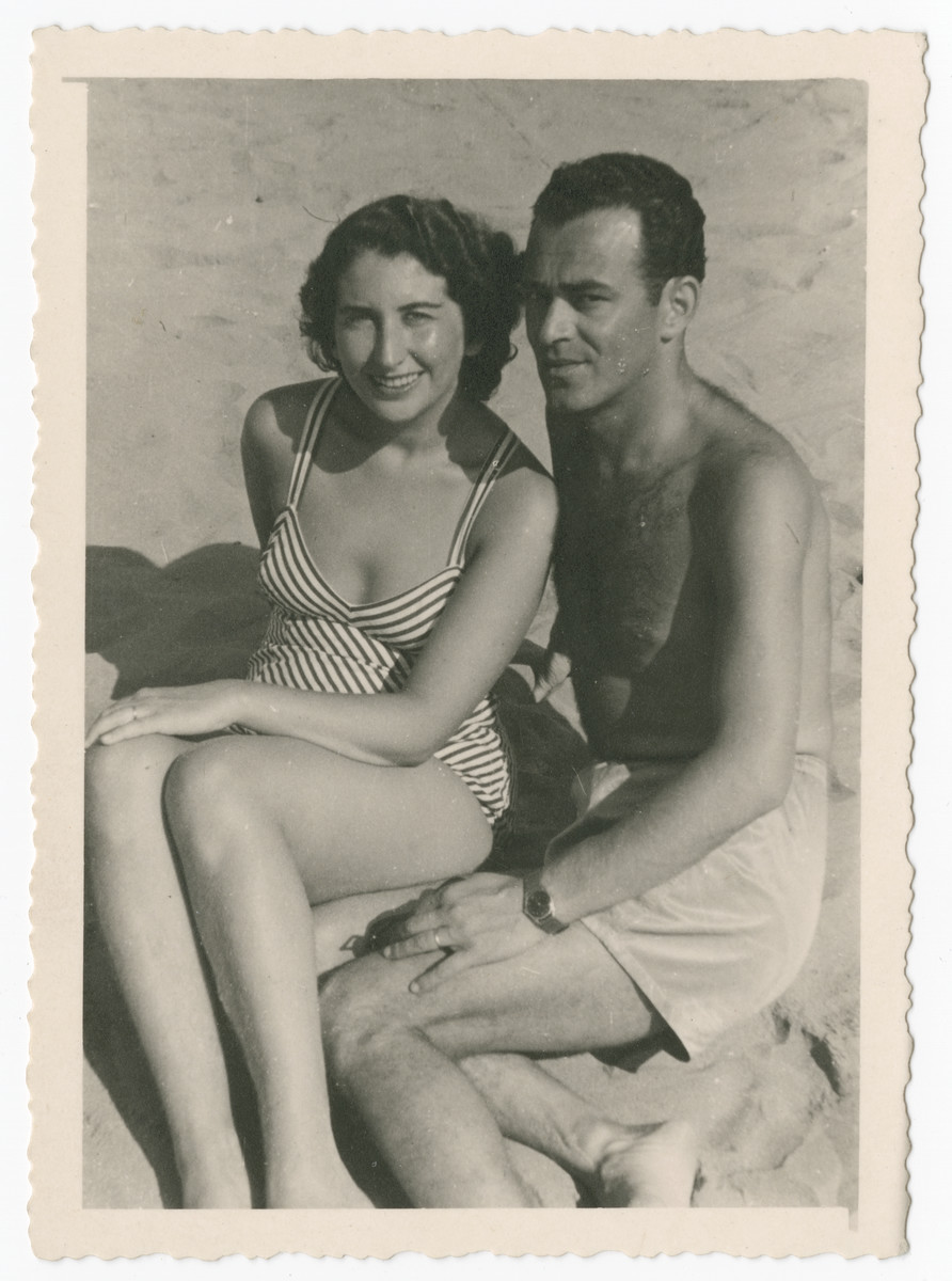 Greta and Simon Beer relax on a beach in postwar Italy.