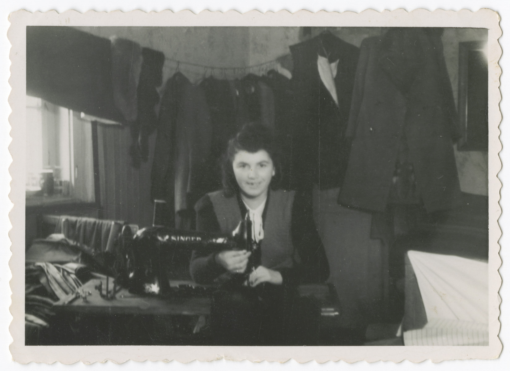 Anna Rosenzweig works at a sewing machine in the Bergen-Belsen displaced persons camp.