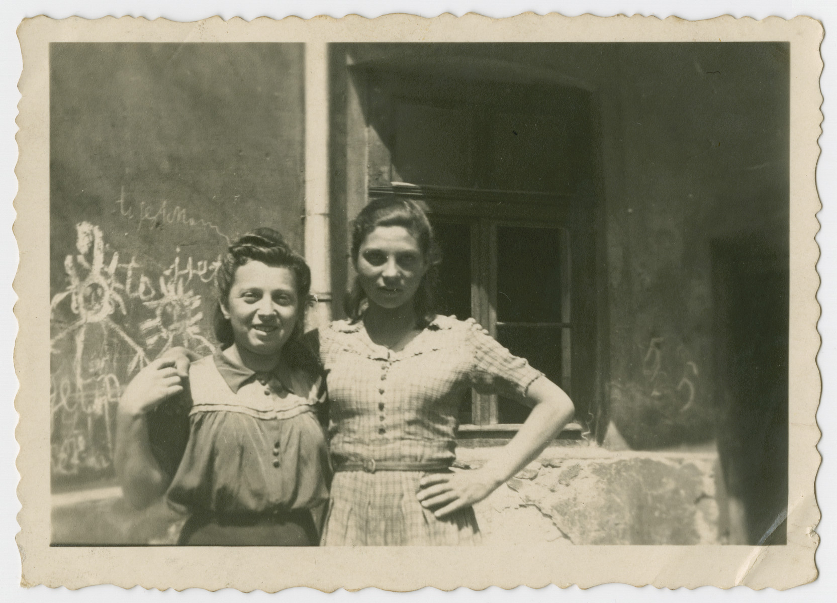 Close-up portrait of two unidentified young women [probably in the Bergen-Belsen displaced persons camp.]