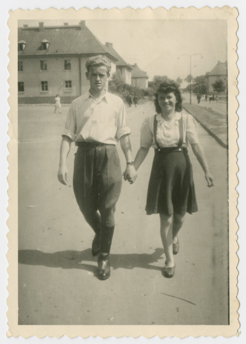 Joe Rosenzweig walks down a street in the Bergen-Belsen displaced persons camp hand in hand with his cousin Anna Rosenzweig