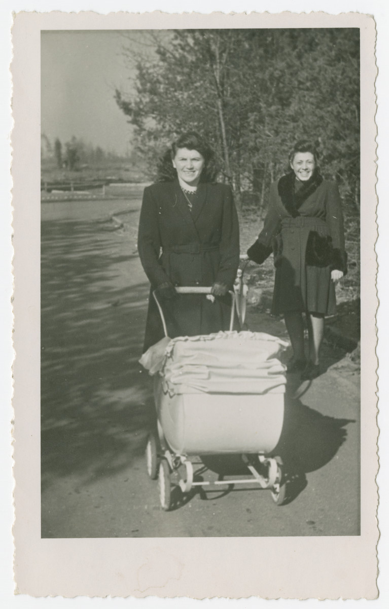Anna Rosenzweig pushes a baby carriage in the Bergen-Belsen displaced persons camp.