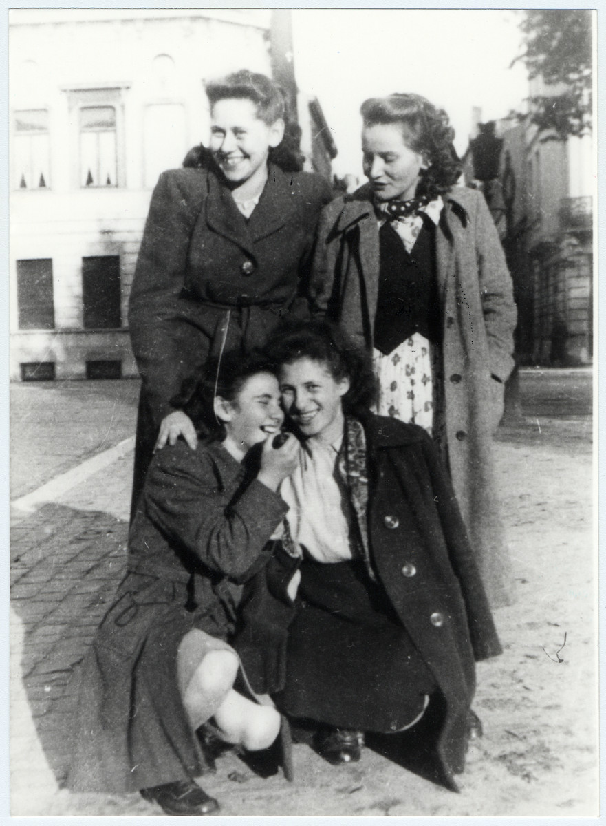 "Four female members of the Gordonia Zionist youth movement pose together on a street in Brussels.  Pictured in front are ""Marie"" and Ida Rosenschtraugh.  Back right is Micki Van der Berk (fiance of Haim Sephiha)."