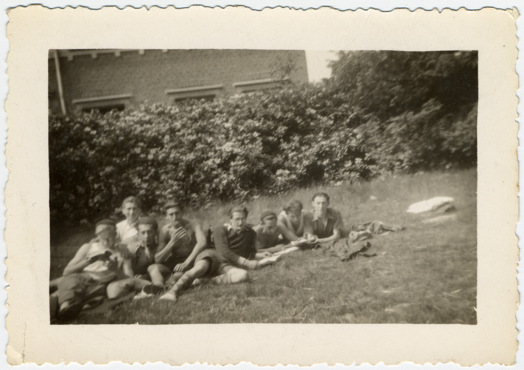 Belgian Jewish youth relax on the grounds of La Ramee, an agricultural training school.  The school was established after Jewish students were expelled from general schools  and directed by Haroun Tazieff.