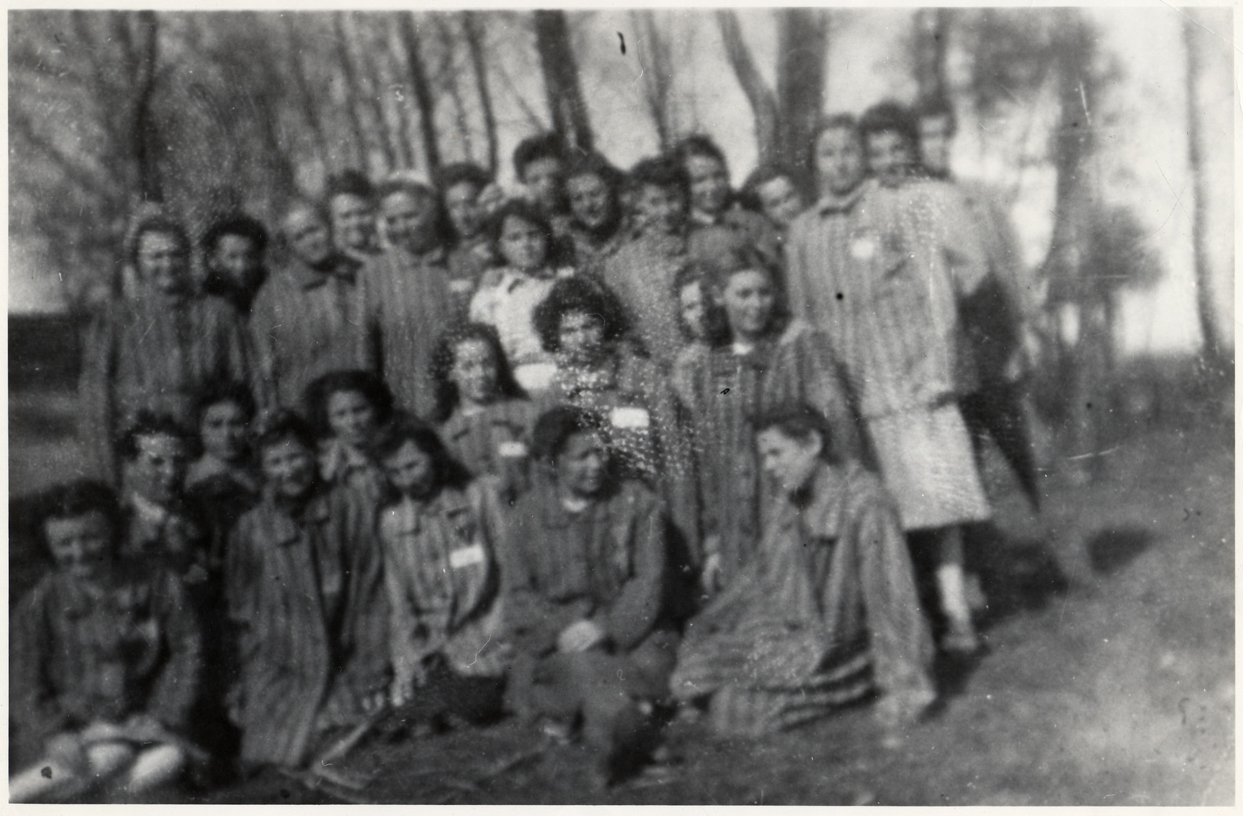 Group portrait of French and Belgian Jewish women recently liberated from the Ravensbrueck concentration camp.  Germaine Sephia is standing on the far left, and Esther Sephia is third from the left.  The SS had singled them out as Turkish citizens and put them in a separate block.