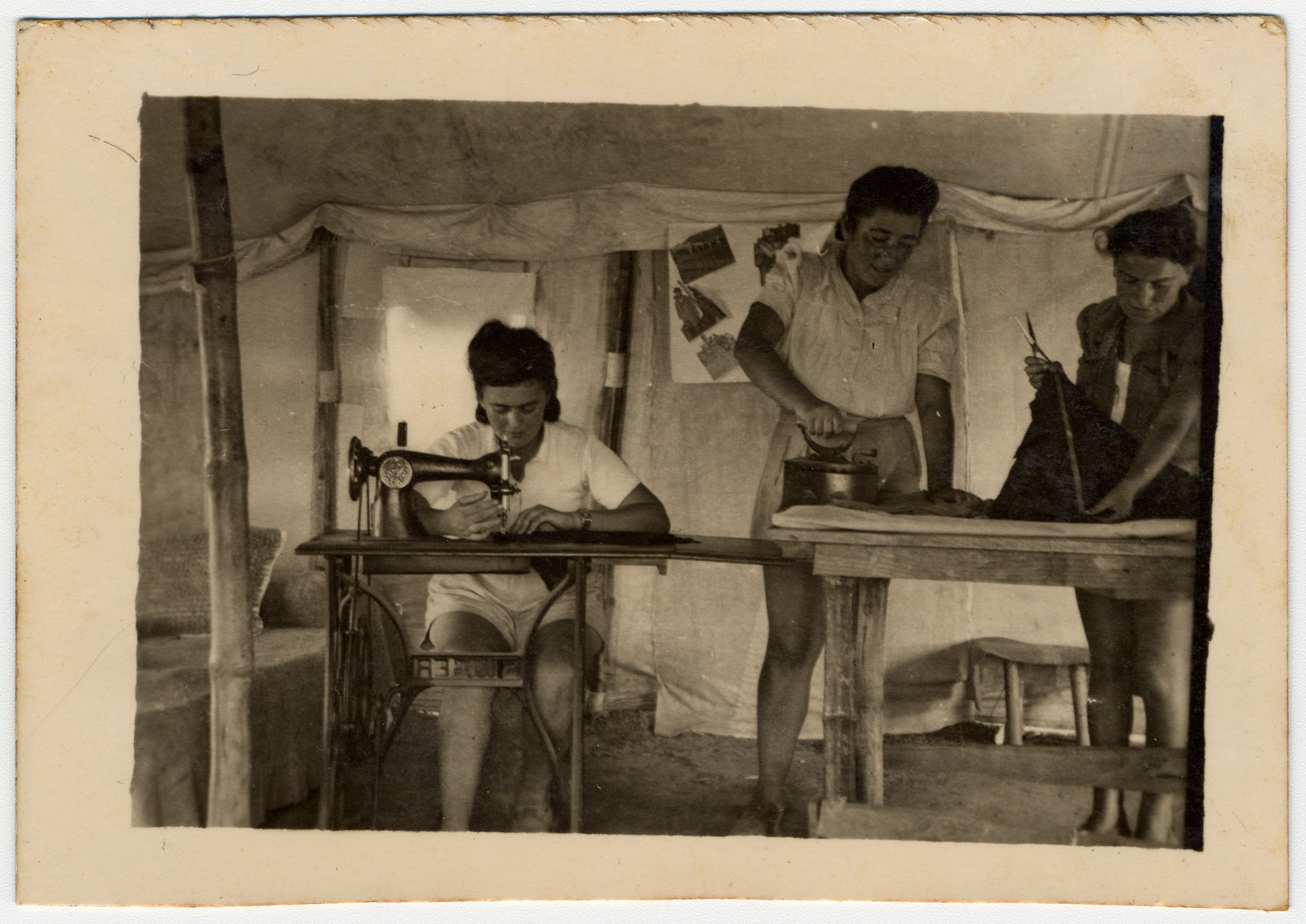 Female Jewish displaced persons working in a sewing circle at a refugee camp in Cyprus.   Pictured on the left is Chana (Goldberg) Grycman.