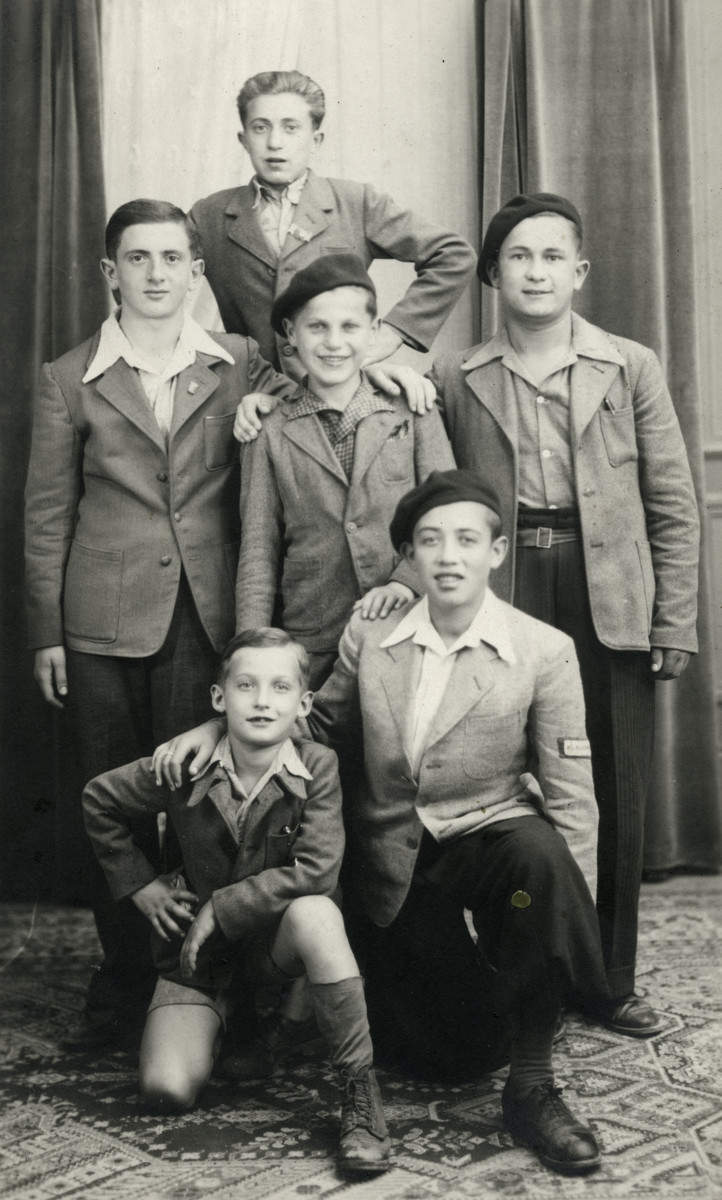 Group portrait of boys in the Ambloy children's home.  Kaminsky at very top, Binem Wrzonski is second row left, Izio is bottom left and Jacques Rybsztjan is bottom right.
