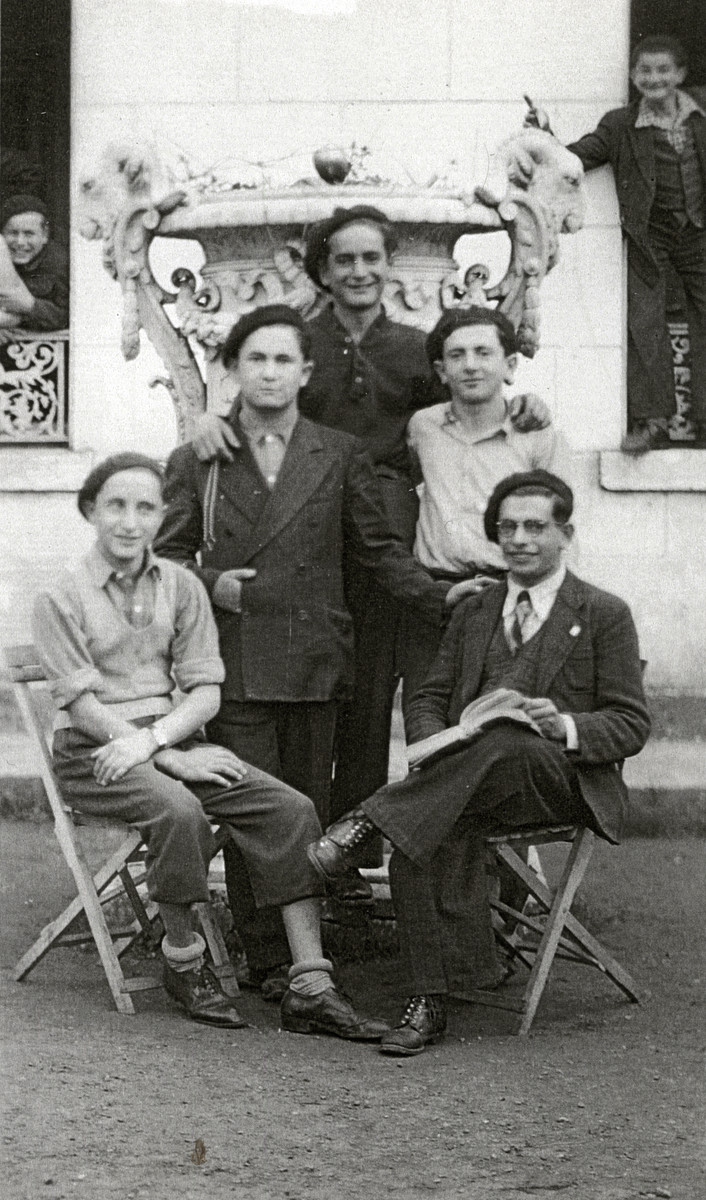 Group portrait of boys in the Ambloy children's home.  Pictured front left Kalman Kalikstein, Binem Wrzonski (middle right), and Elie Wiesel (back center).