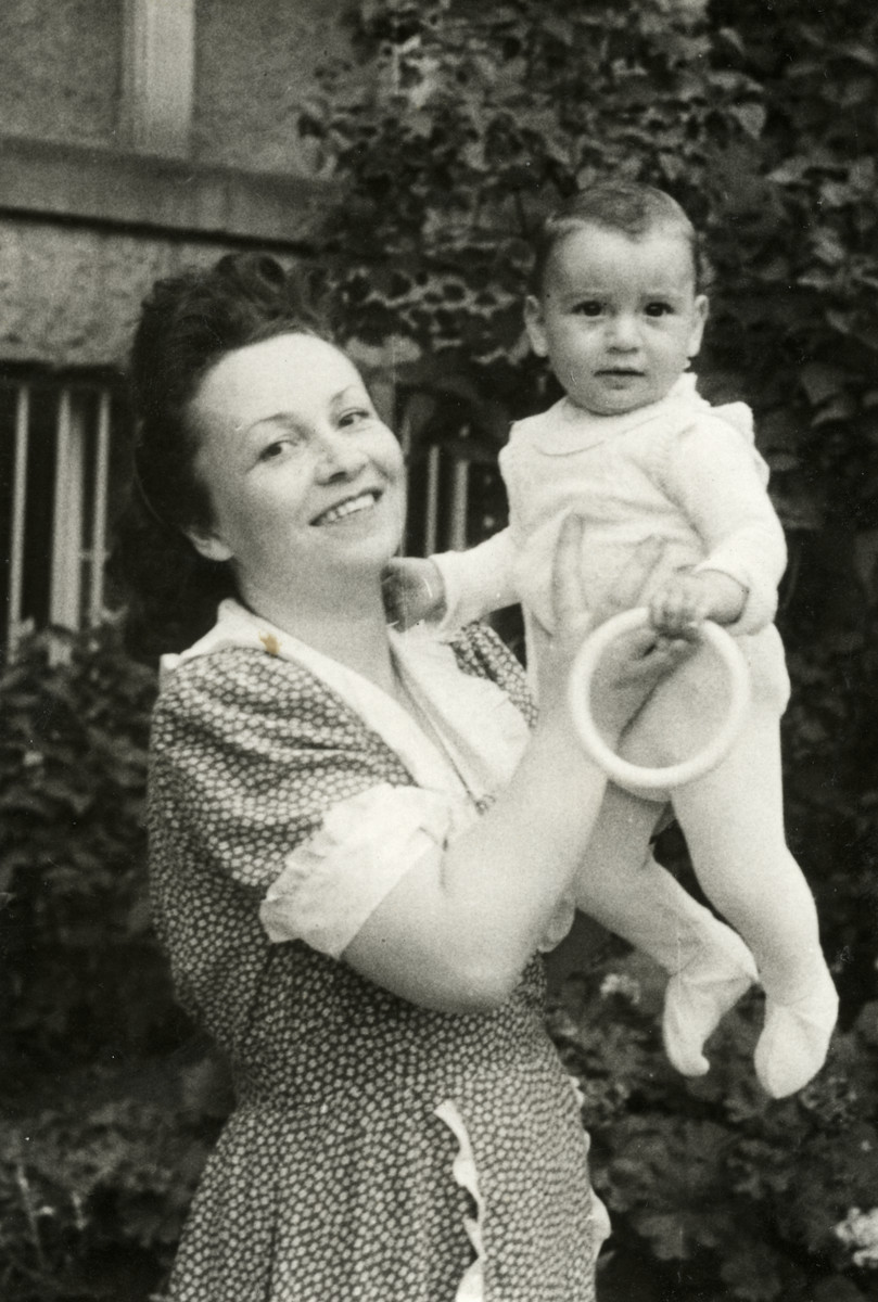 Chana Hershtyn holds one of her baby daughters.