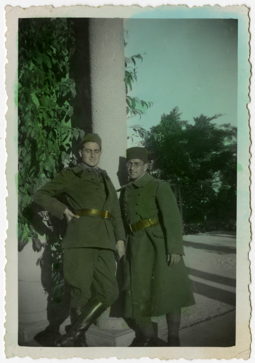 "Colorized close-up portrait of two Algerian brothers, Albert (left) and Andre (right) Benichou, serving in the French army in Tunisia,   The original caption reads ""With my older, beloved brother, souvenir of a day that was much too short, Andre."""