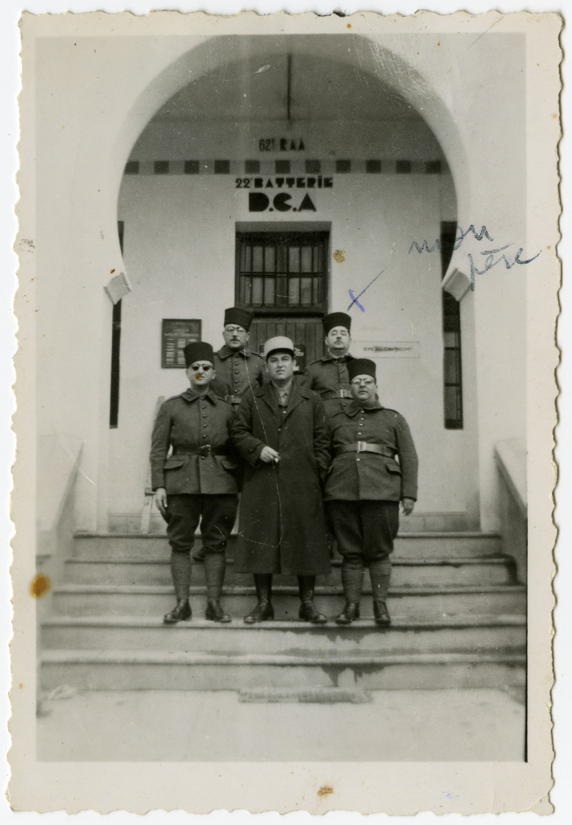 Five French Algerian soldiers pose on the steps of the Bardo Palace on the outskirts of Tunis, which was converted into a military barracks.  Jacques El Haik (the father of Arlette Benichou) is standing in the second row on the right.