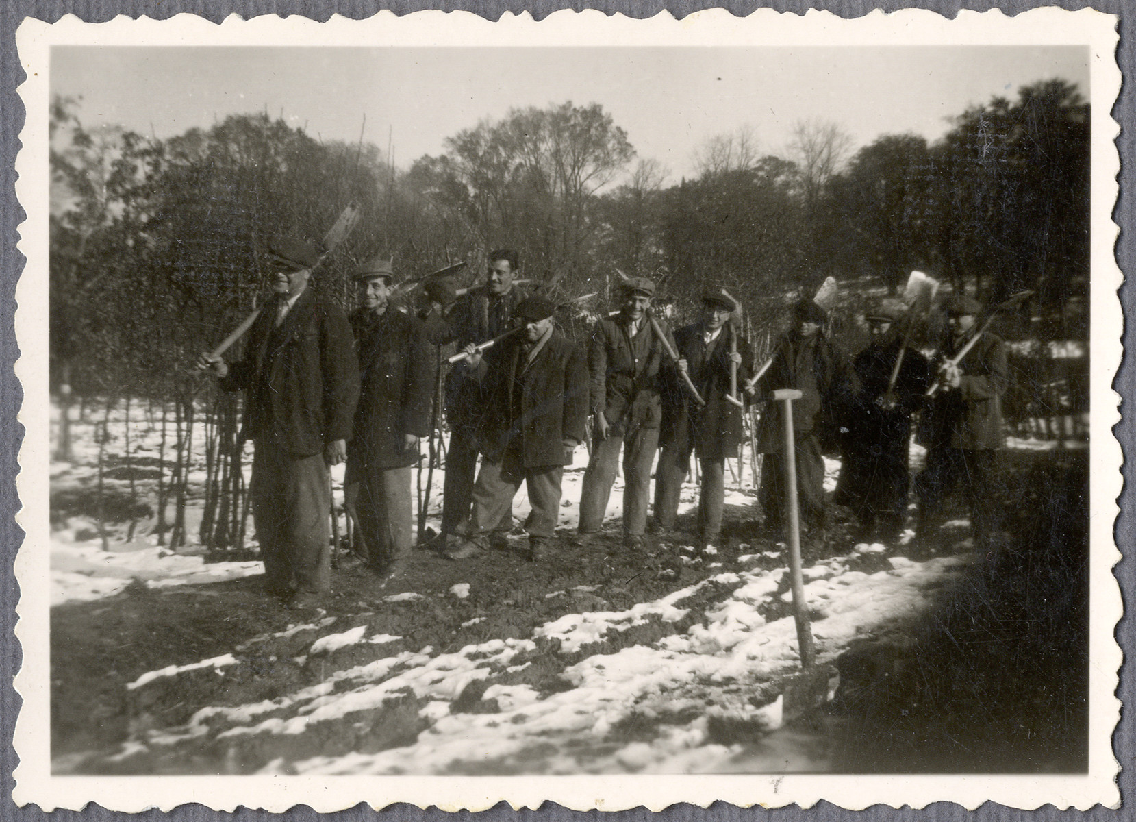 Jewish workers from the Lipa farm labor camp line up with their shovels in Cervene Pecky where they were allowed to work for a week in the spring of 1942.