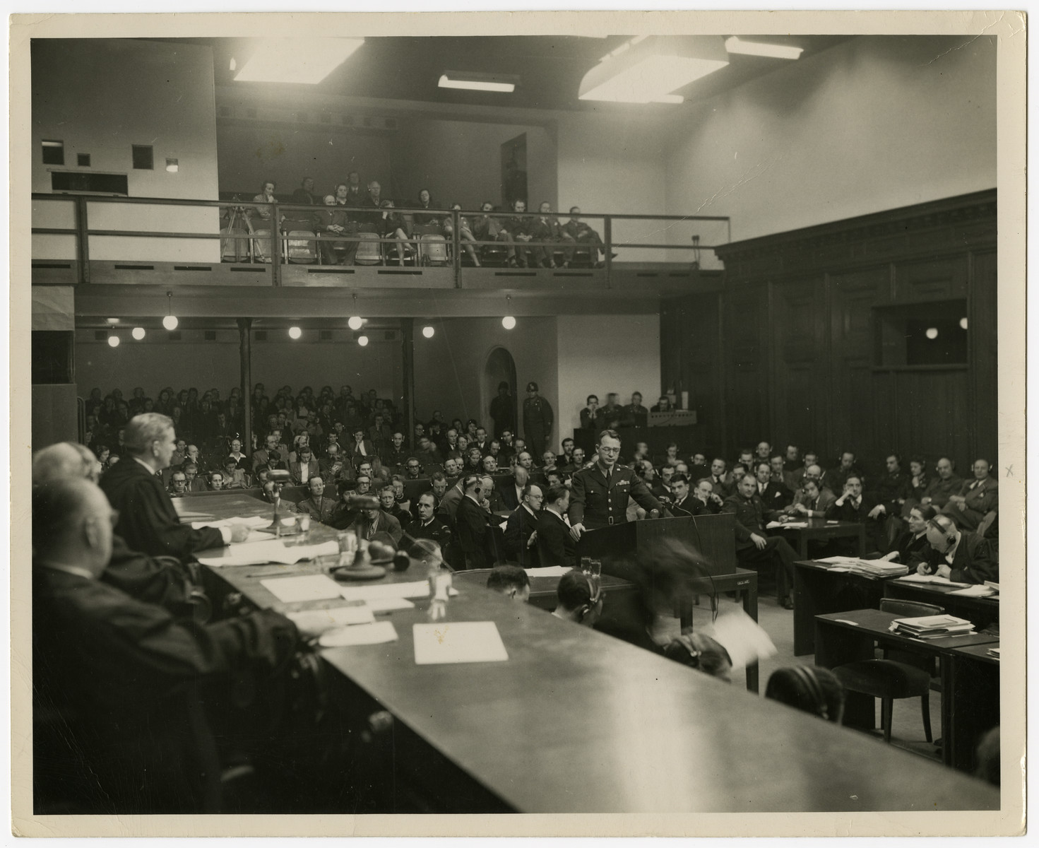 Telford Taylor, chief prosecutor of the Krupp Trial, testifies.  Seated to the right are the justices.