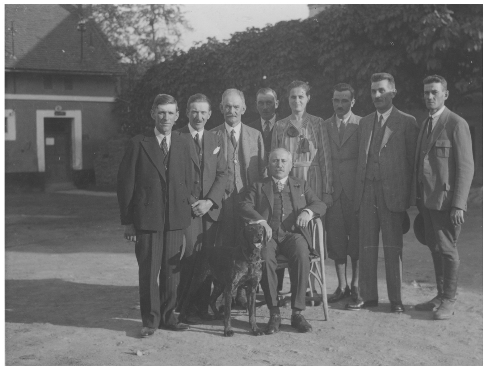 Julius Kraus poses with the employees of his farm.  His estate later became the site of the Lipa farm labor camp.  Karel Kraus is pictured second from the left.