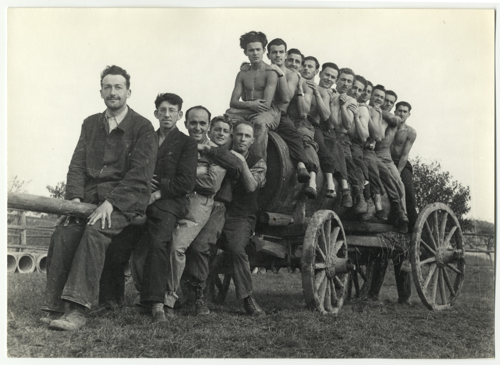 A group of Jewish workers pose atop a wagon in the Lipa farm labor camp.
