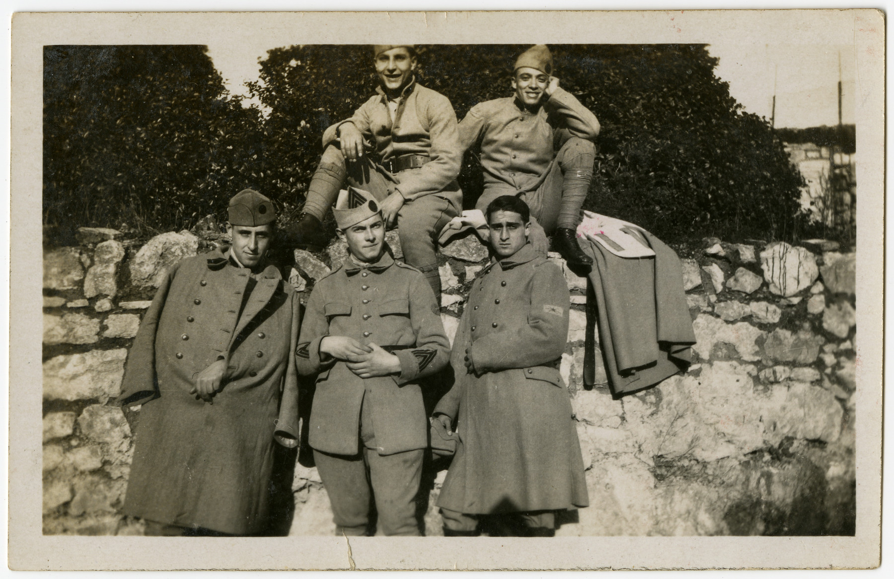 Albert Benichou, an Algerian Jew serving in the French army, poses with other recruits while in training in Tunisia.  Albert Benichou is pictured in the front row on the far right.