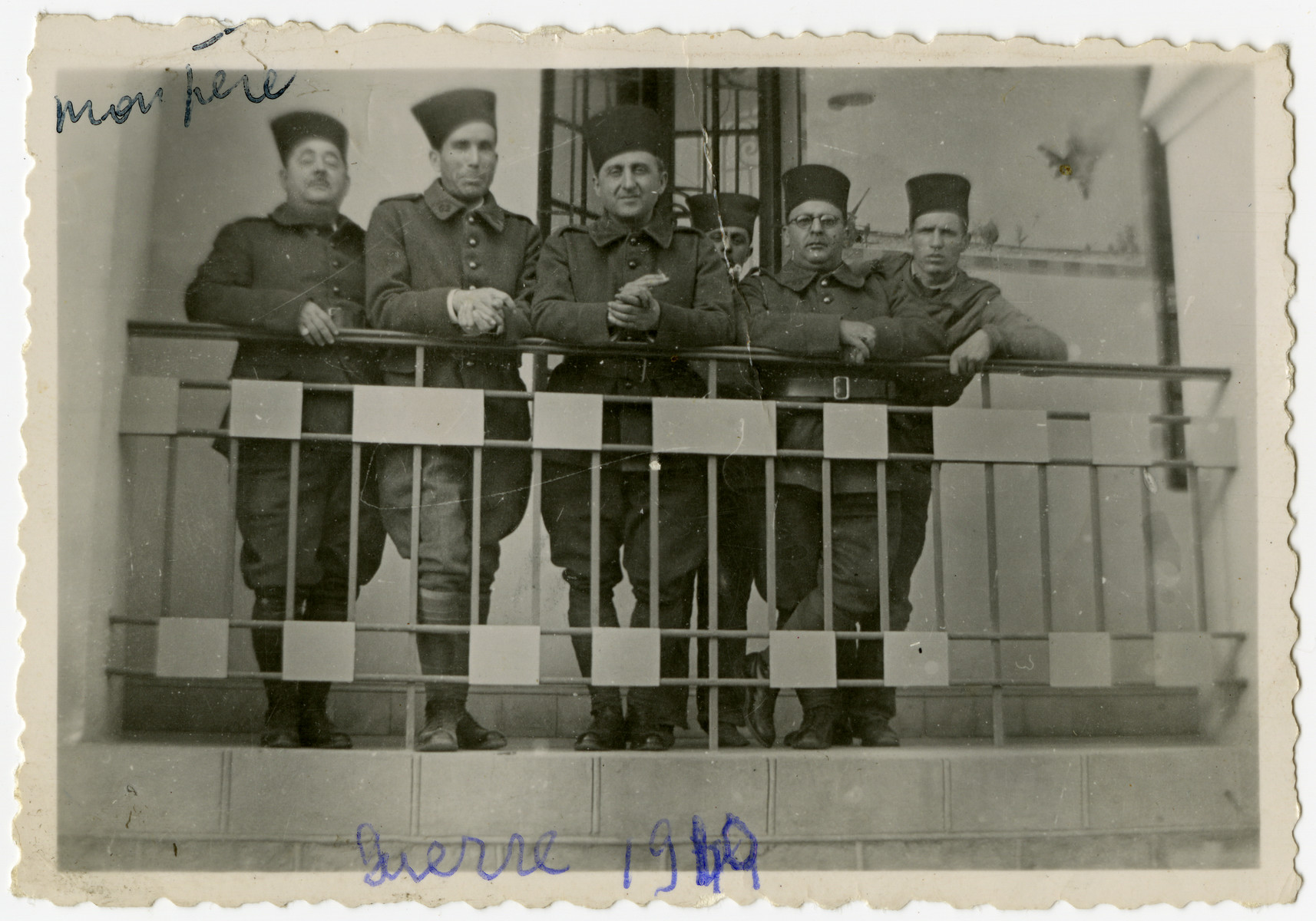 French Algerian soldiers pose on the balcony of the Bardo Palace on the outskirts of Tunis, which was converted into a military barracks.  Jacques El Haik (the father of Arlette Benichou) is standing on the left.