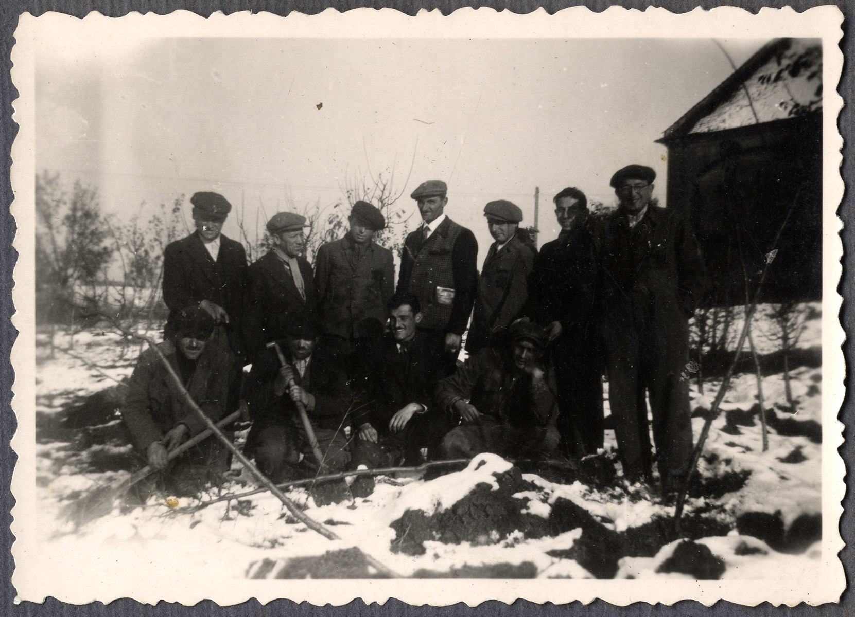 """Group portrait of Jewish workers from the Lipa farm labor camp in Cervene Pecky where they were allowed to work for a week in the spring of 1942.  The original caption reads """"last photo, last year."""""""
