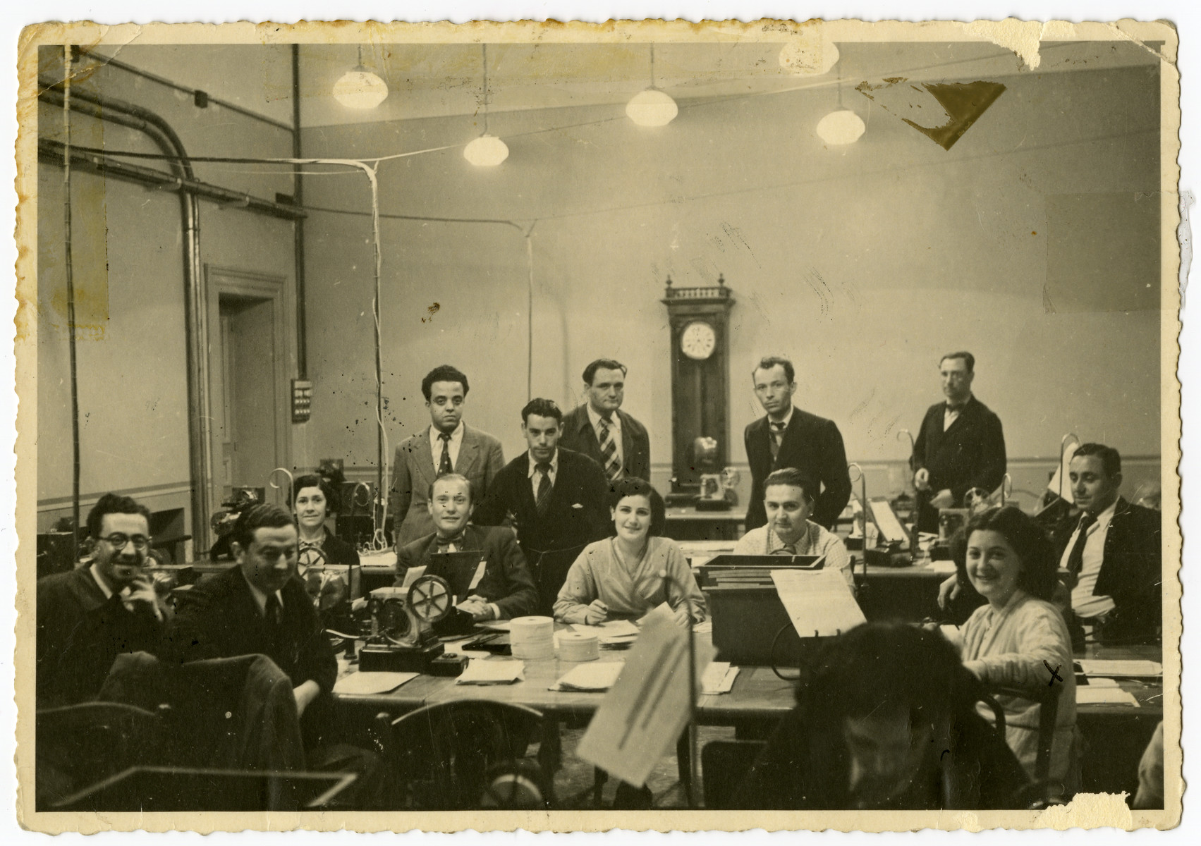 Workers of the Central Telegraph Office in Tunis operate their teletypes.  Arlette el Haik (later Benichou) is seated in the right hand corner.
