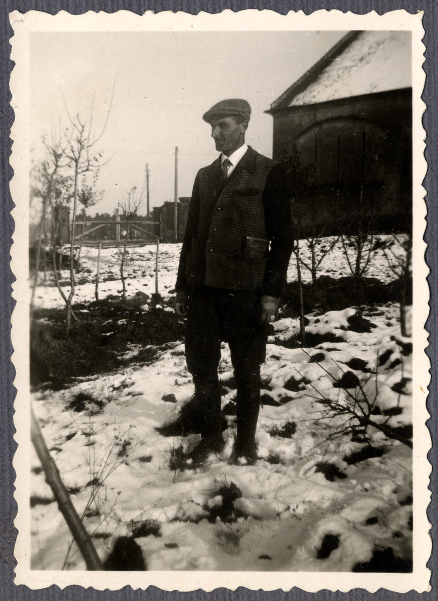 Close-up portrait of one Jewish worker from the Lipa farm labor camp in Cervene Pecky where he was allowed to work for a week in the spring of 1942.