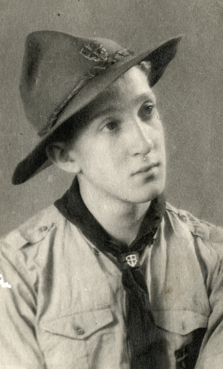 Portrait of Joseph Emir wearing a Jewish scout uniform.  He was captured, tortured and later killed on Mount Valerian.