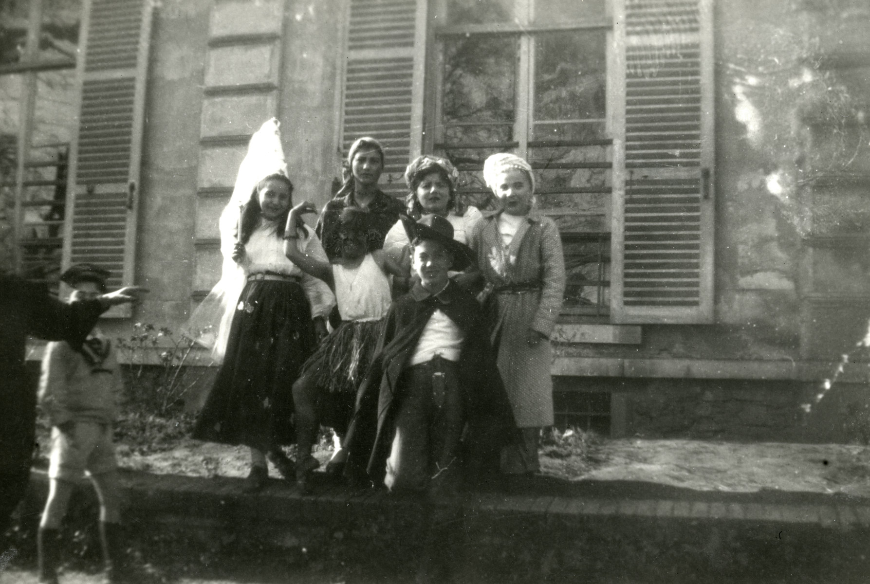 Children pose in their Purim costumes in the Taverny (Vaucelles) children's home.