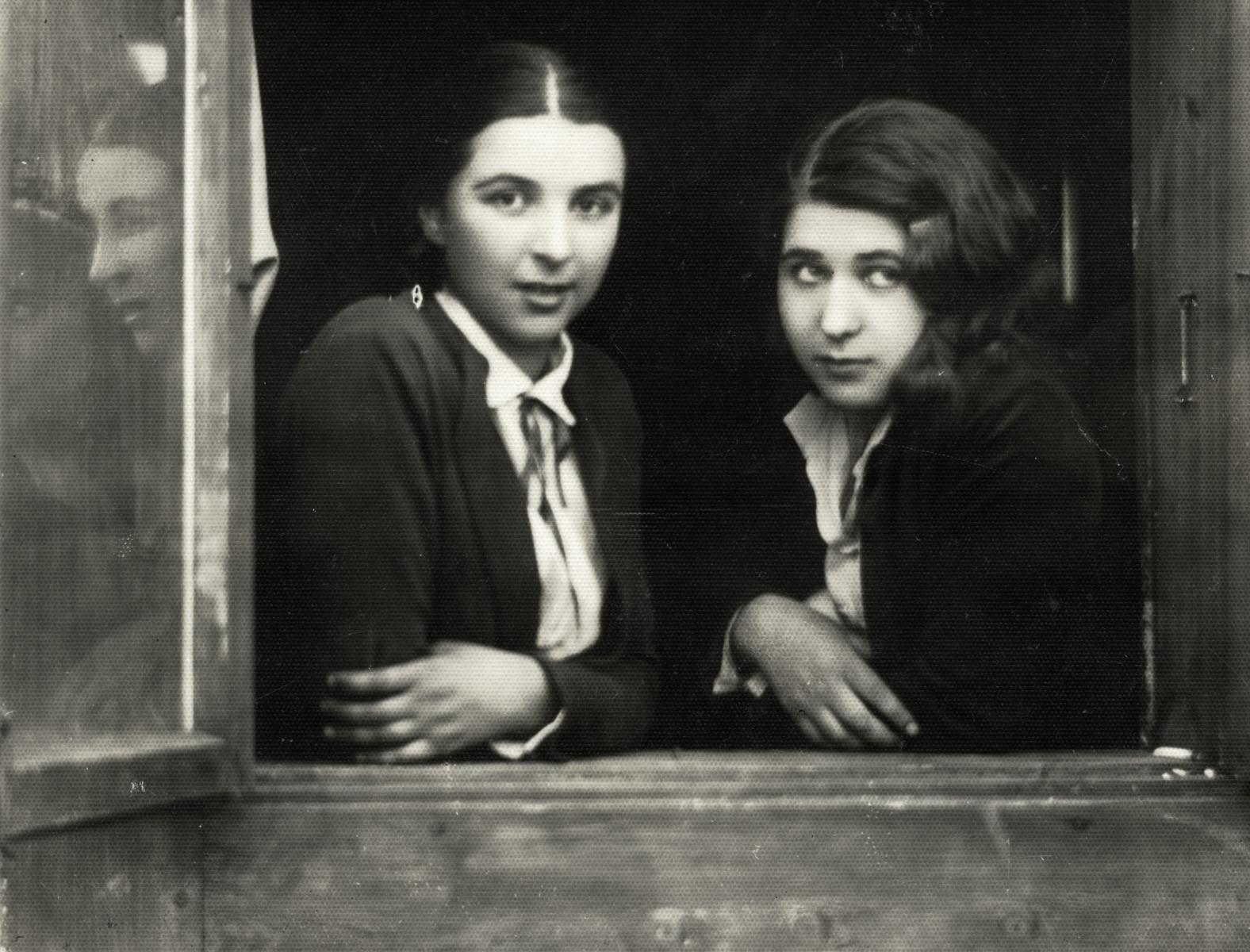Close-up portrait of two Jewish young women, Shoshana Weiner and Chana Rudashevsky, in prewar Vilna.