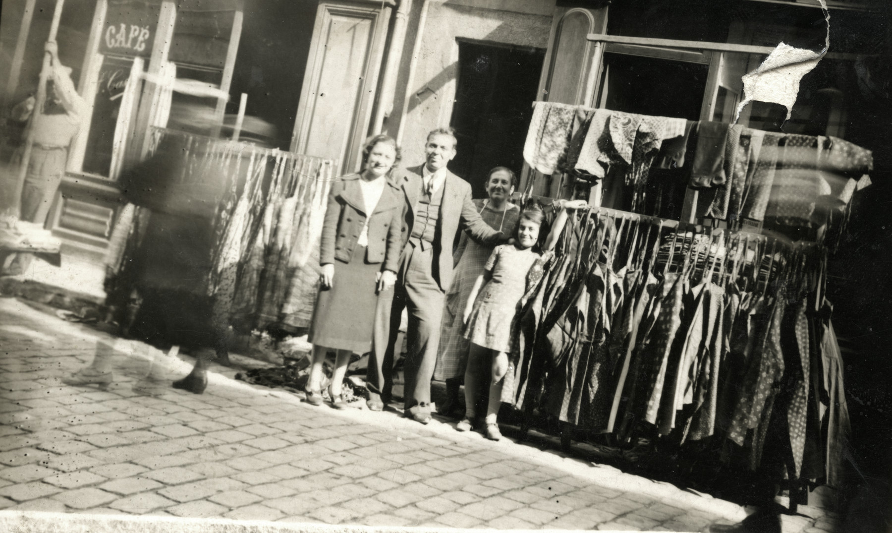 Esther poses with her father Shimon Romano in front of their clothing store in Lyon.
