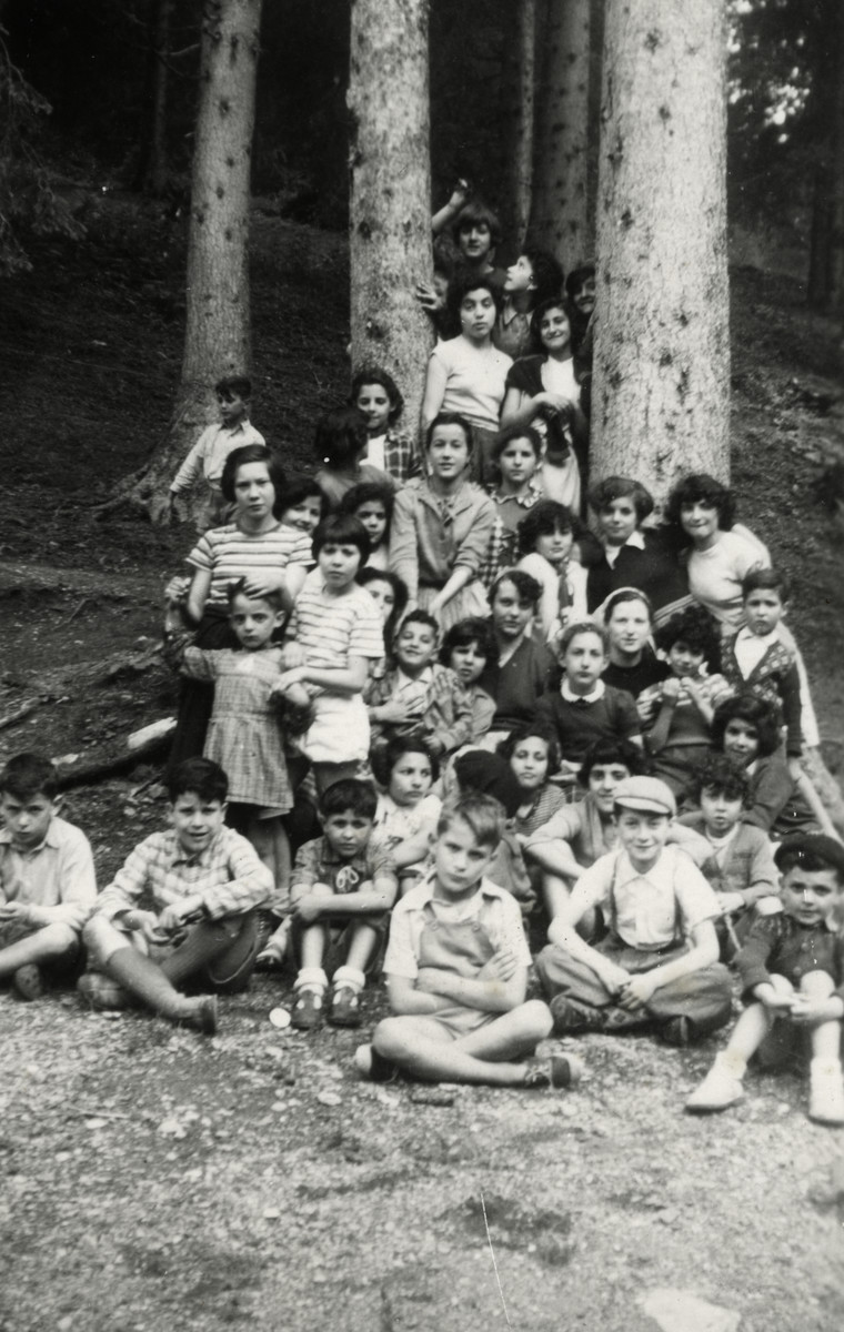 Children from the OSE Home de la Foret children's vacation colony pose in the woods.