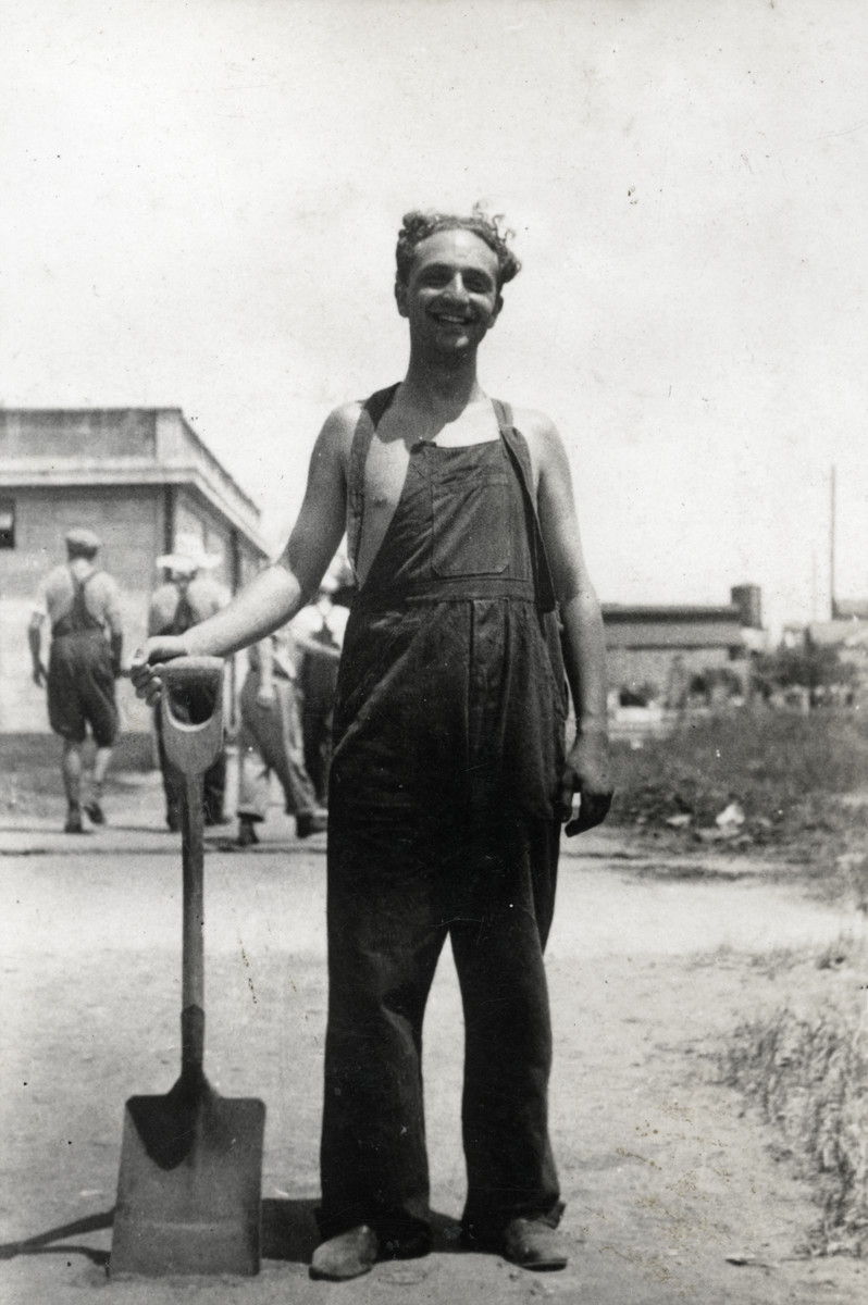 Kurt Markus poses with his shovel in the Pingliang roand Refugee Camp in Shanghai, China.