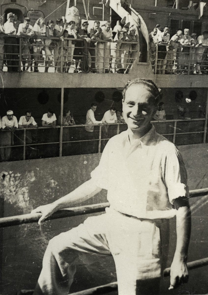 Kurt Marcus poses against a railing while working for the American navy after the war.