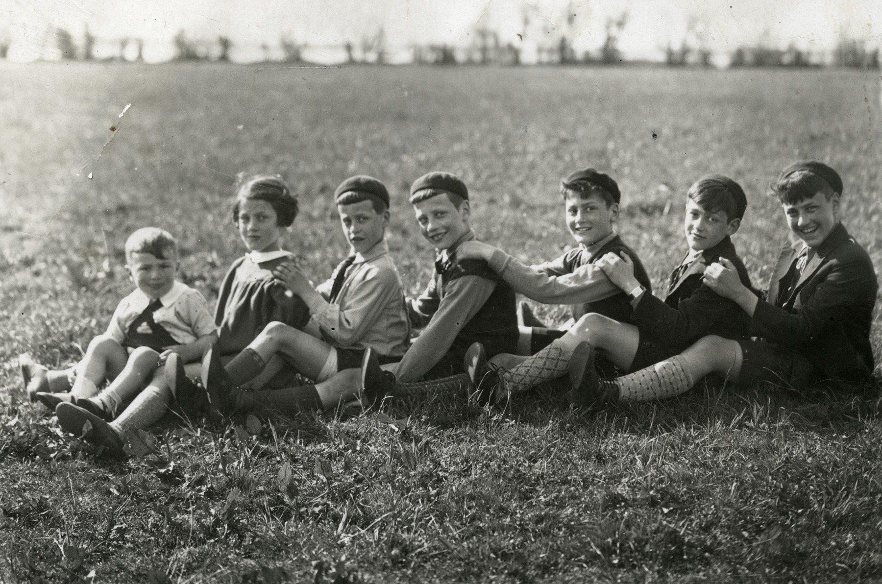 The Emanuel children go on an excursion near Rotterdam on Lag Ba'Omer.  From right to left: Elchanan, Shlomo, Yona, Shmuel, Baruch, Bella, and Shalom.