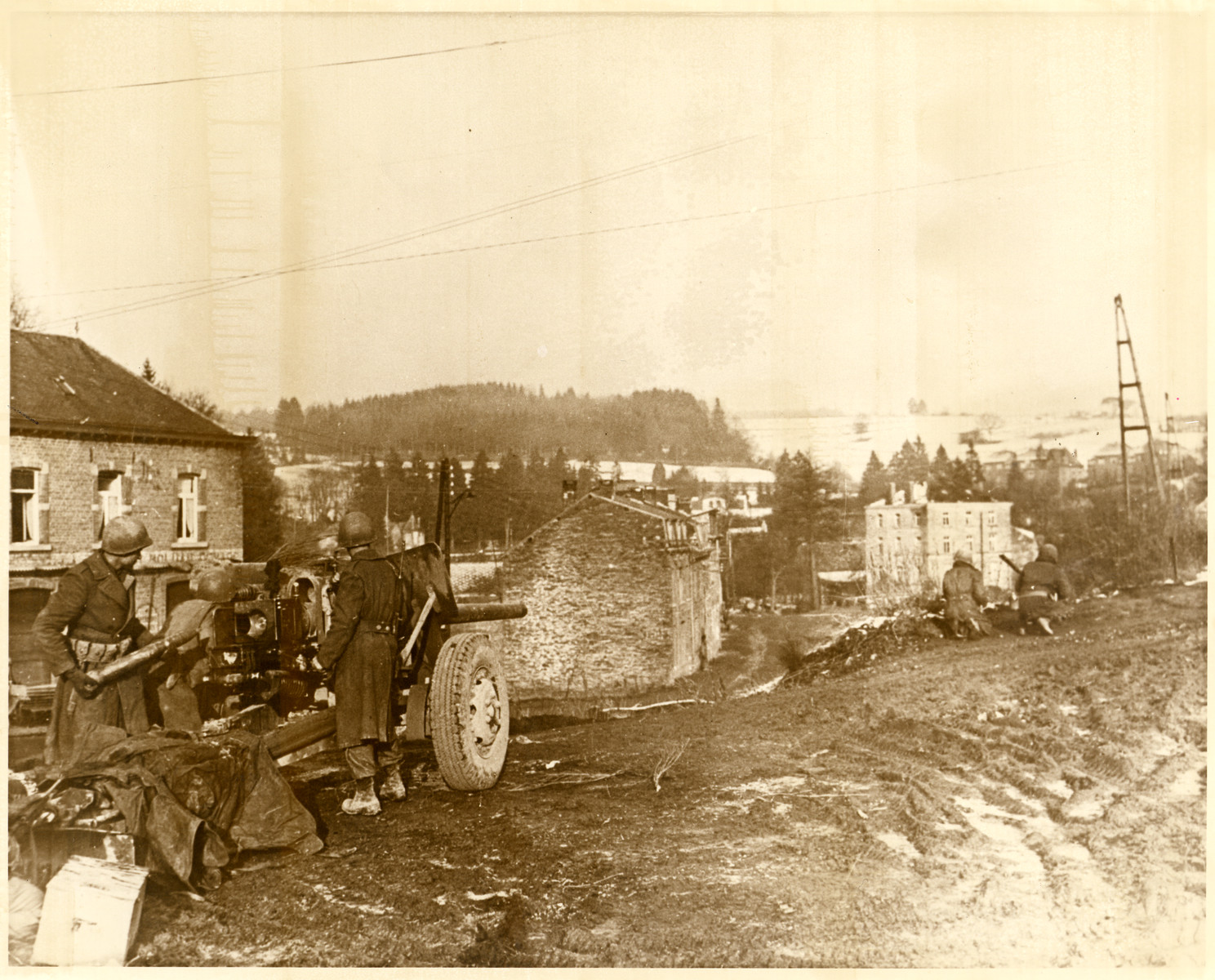 American forces load their weapons and prepare for action in an unidentified town.