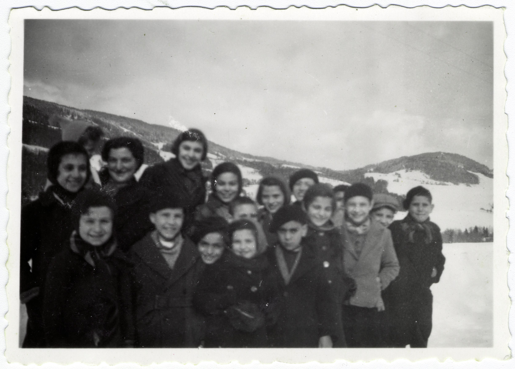 Denise Bloch poses with the children in her care [probably in Les Mirabelles].